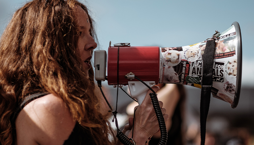 Protestor with megaphone, talking