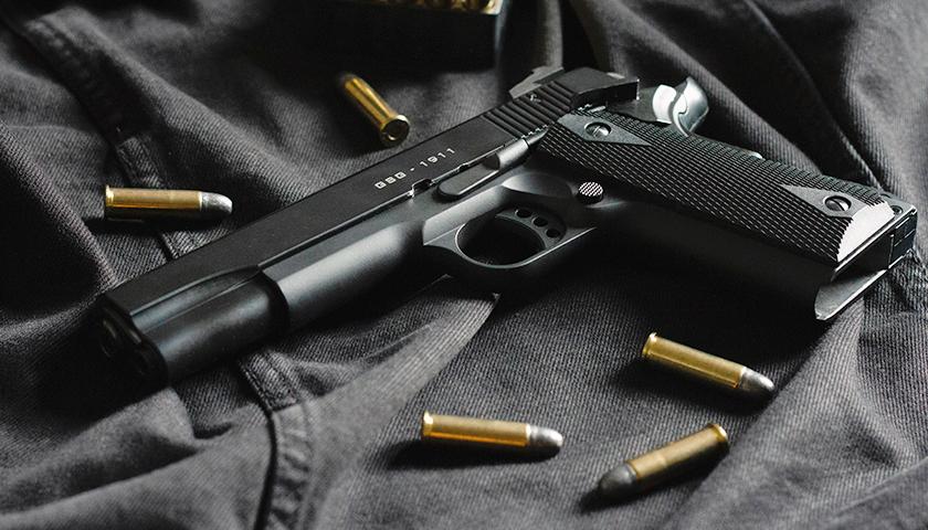 handgun with ammo