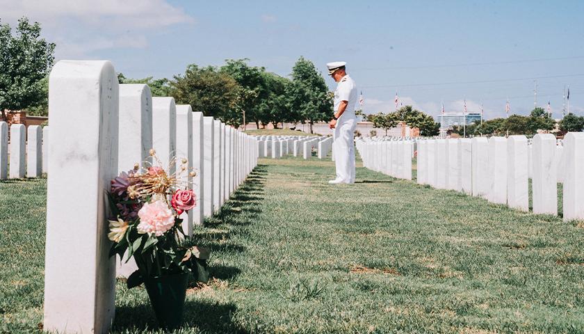 Soldier at gravesite of U.S. veterans
