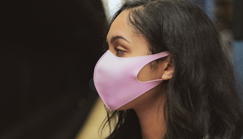 Girl with mask on