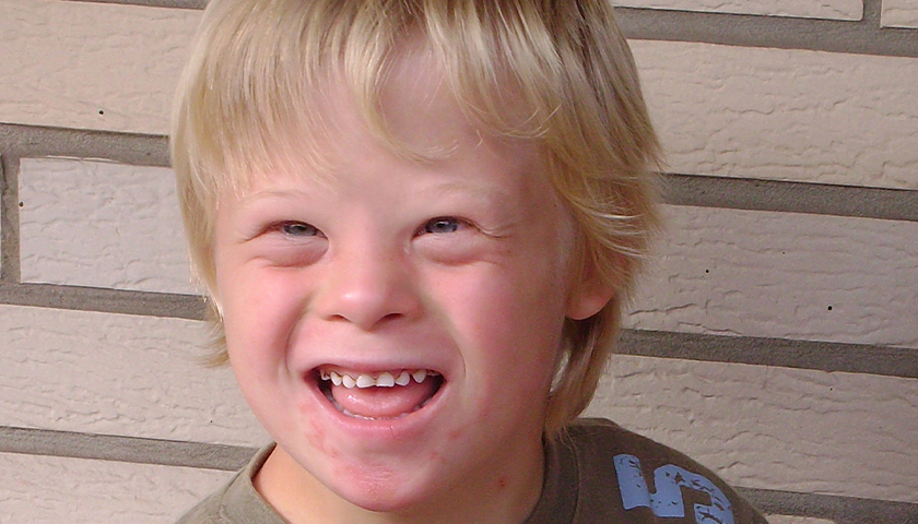 Young blonde boy with down syndrome