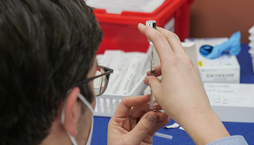 Doctor preparing COVID-19 Vaccine