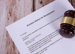 Eviction Notice for Nonpayment document with a wooden judge gavel