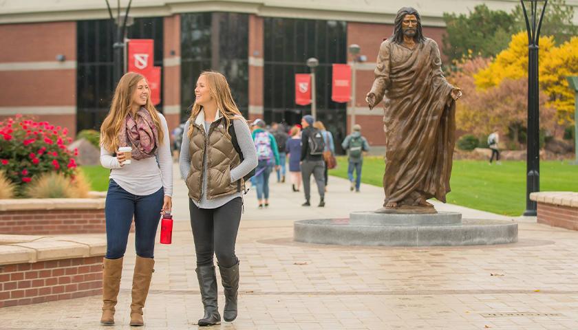 Two students walking on Northwest Nazarene University campus