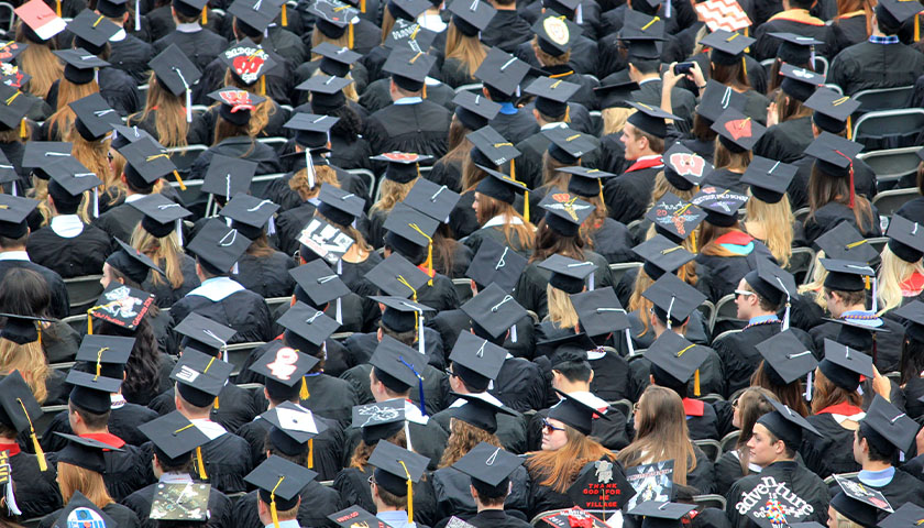 A see of college graduates at the commencement ceremony.
