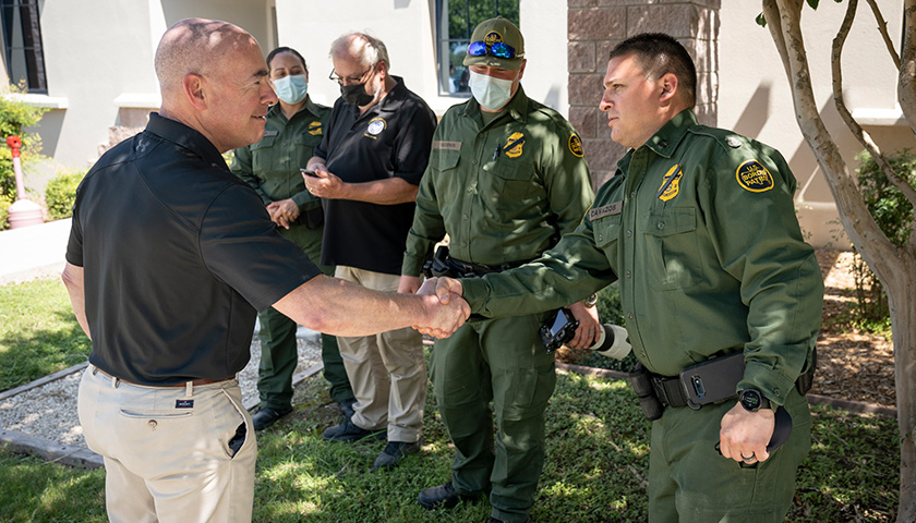 U.S. Dept. of Homeland Security Secretary Alejandro Mayorkas visits with a group of Border Patrol agents and CBP employees as he tours the Del Rio Port of Entry in Del Rio, Texas, September 20, 2021. DHS photo by Benjamin Applebaum