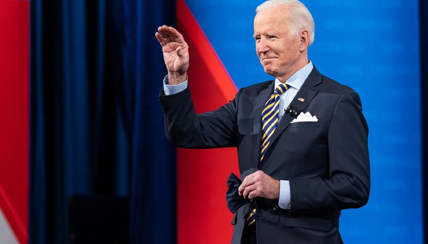 Joe Biden waving on a stage